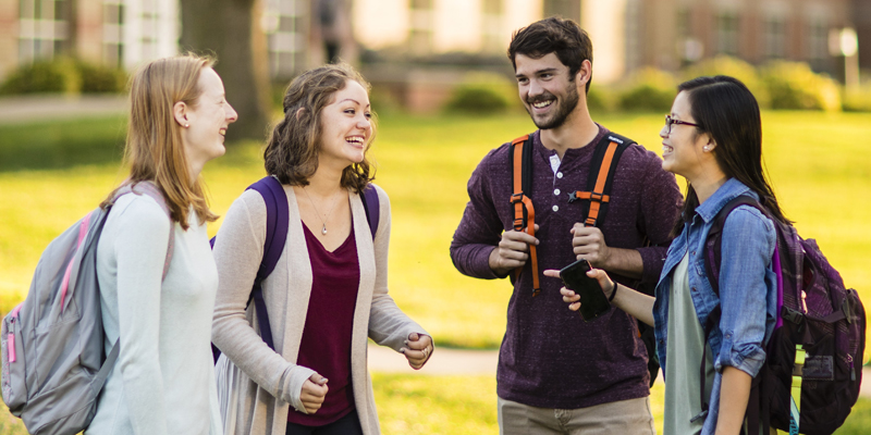 Four Northwestern students talking on campus