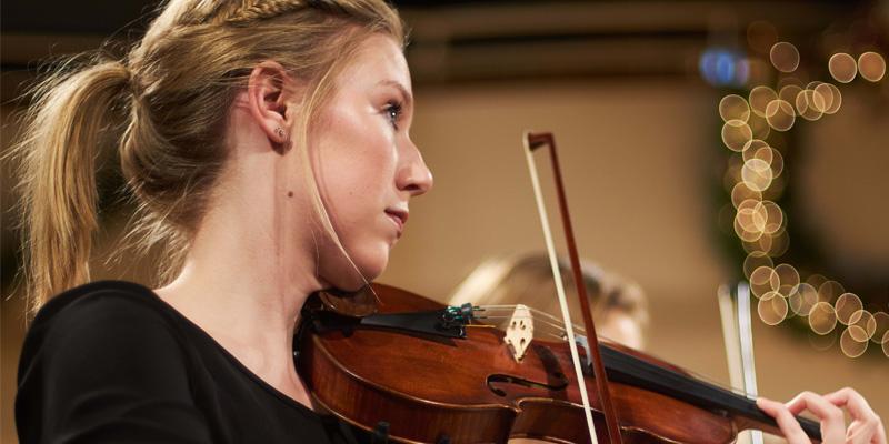 Northwestern student playing the violin