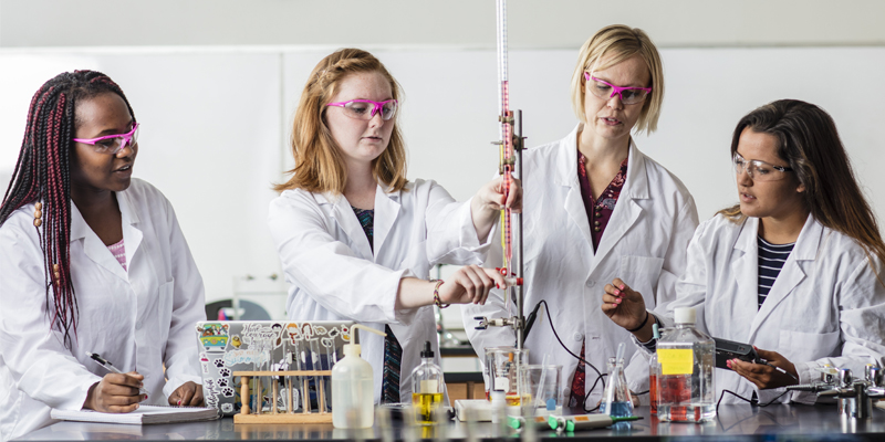 Northwestern students and professor in chemistry lab